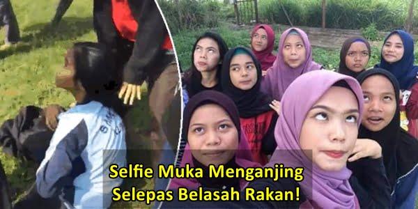 selfie menganjing selepas belasah rakan